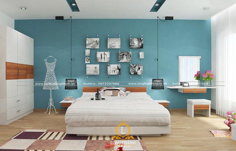 Căn phòng ngủ hiện đại đơn giản với gam màu xanh