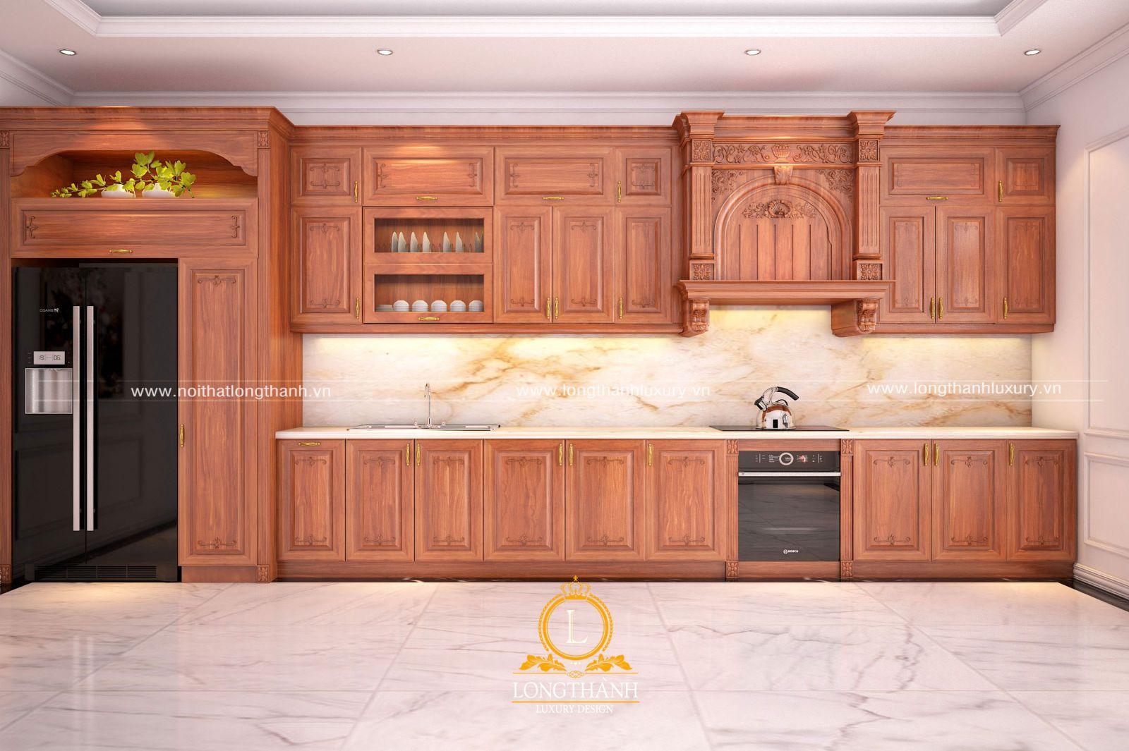Mẫu tủ bếp tân cổ điển gỗ Gõ tự nhiên màu vàng giúp không gian sáng hơn