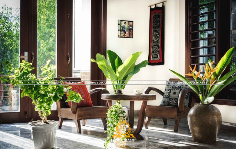 Phòng khách  trang trí cỏ cây hoa lá