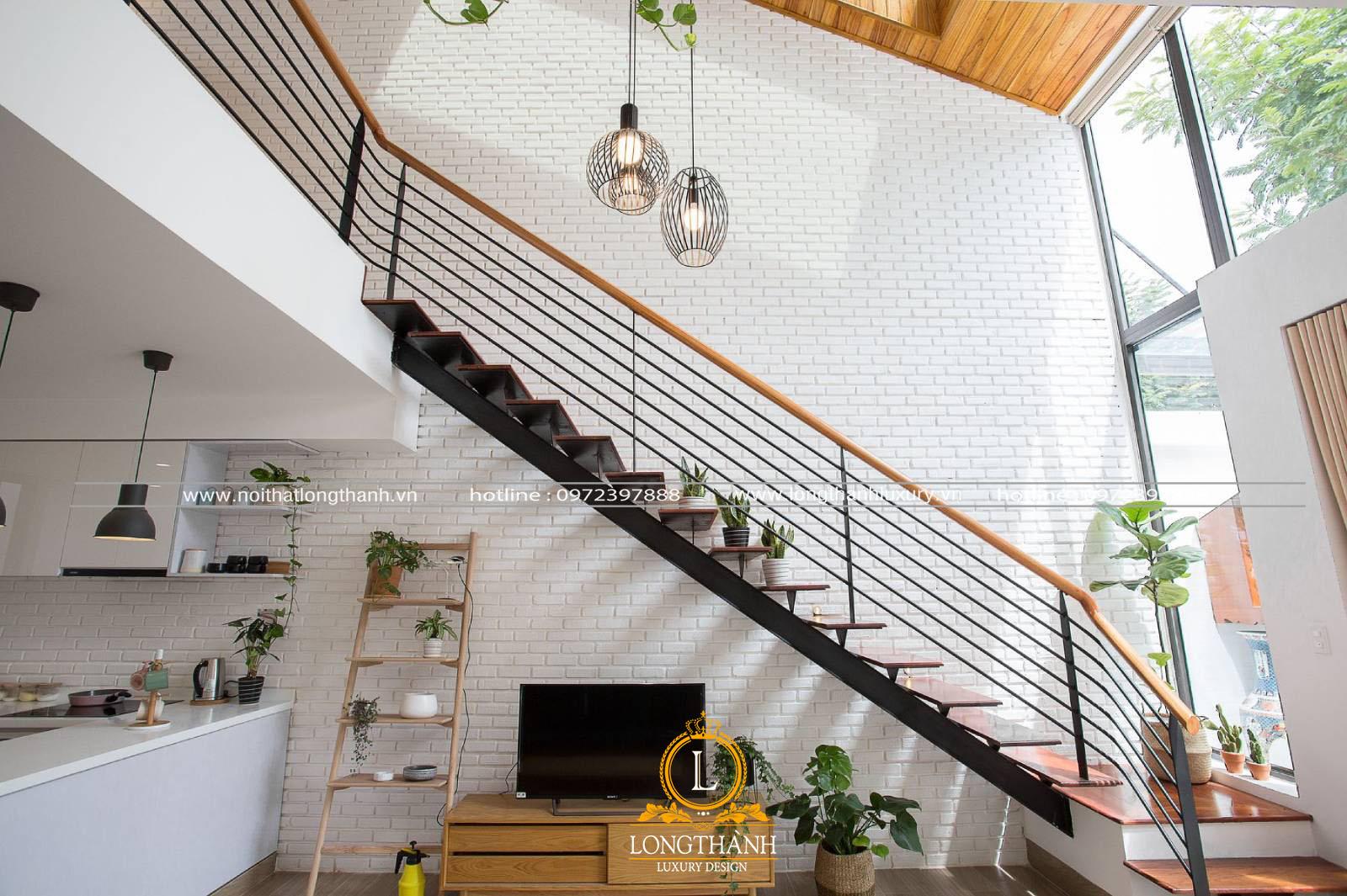 Cầu thang phòng khách được thiết kế theo kiểu hình chữ L