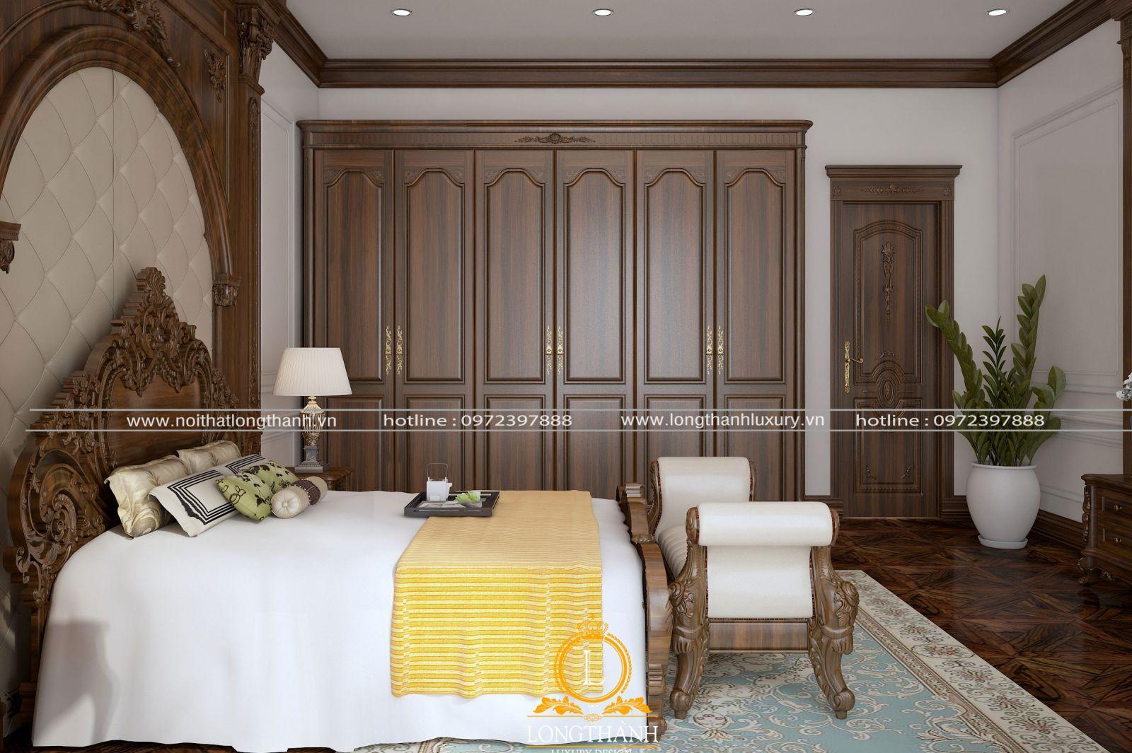 Góc nhìncủa phòng ngủ với tone màu nâu và têm điểm bằng ga giường sắc cam nổi bật