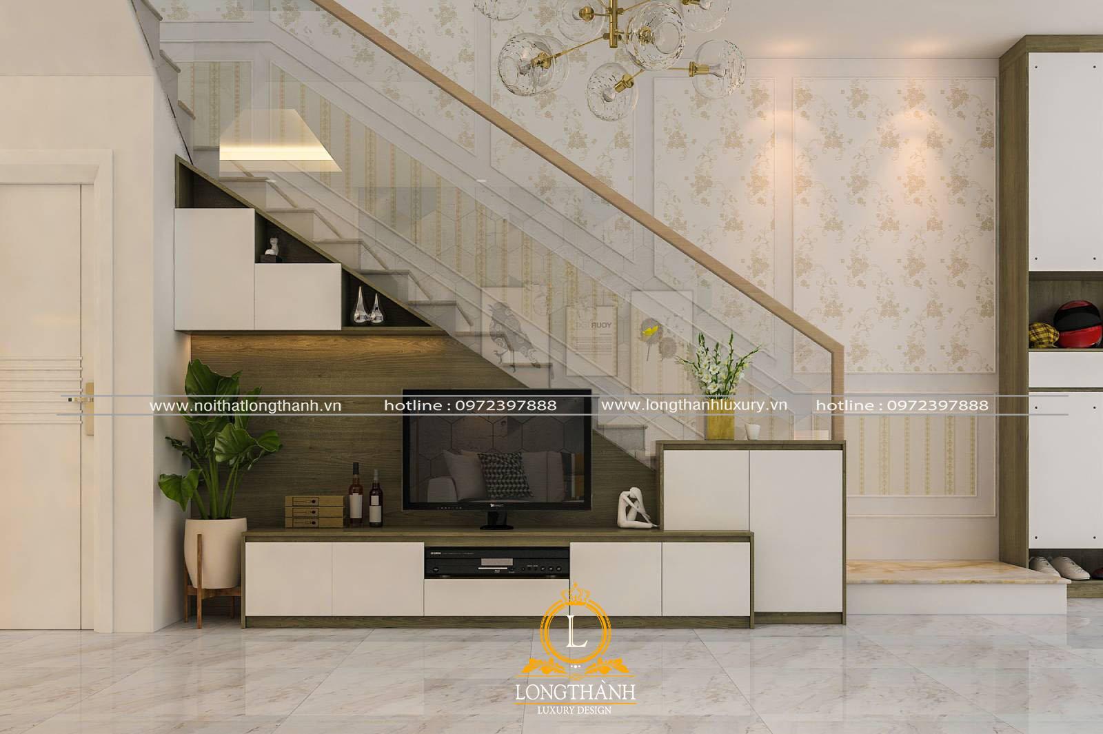 Trang trí kệ tivi dưới dầm cầu thang là điển hình cho thiết kế nhà phố