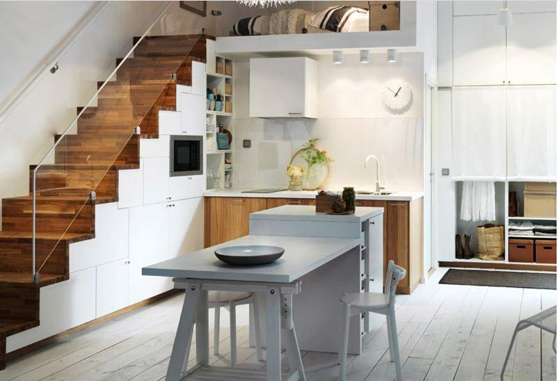mẫu thiết kế tủ bếp dưới gầm cầu thang làm từ gỗ công nghiệp kết hợp acrylic