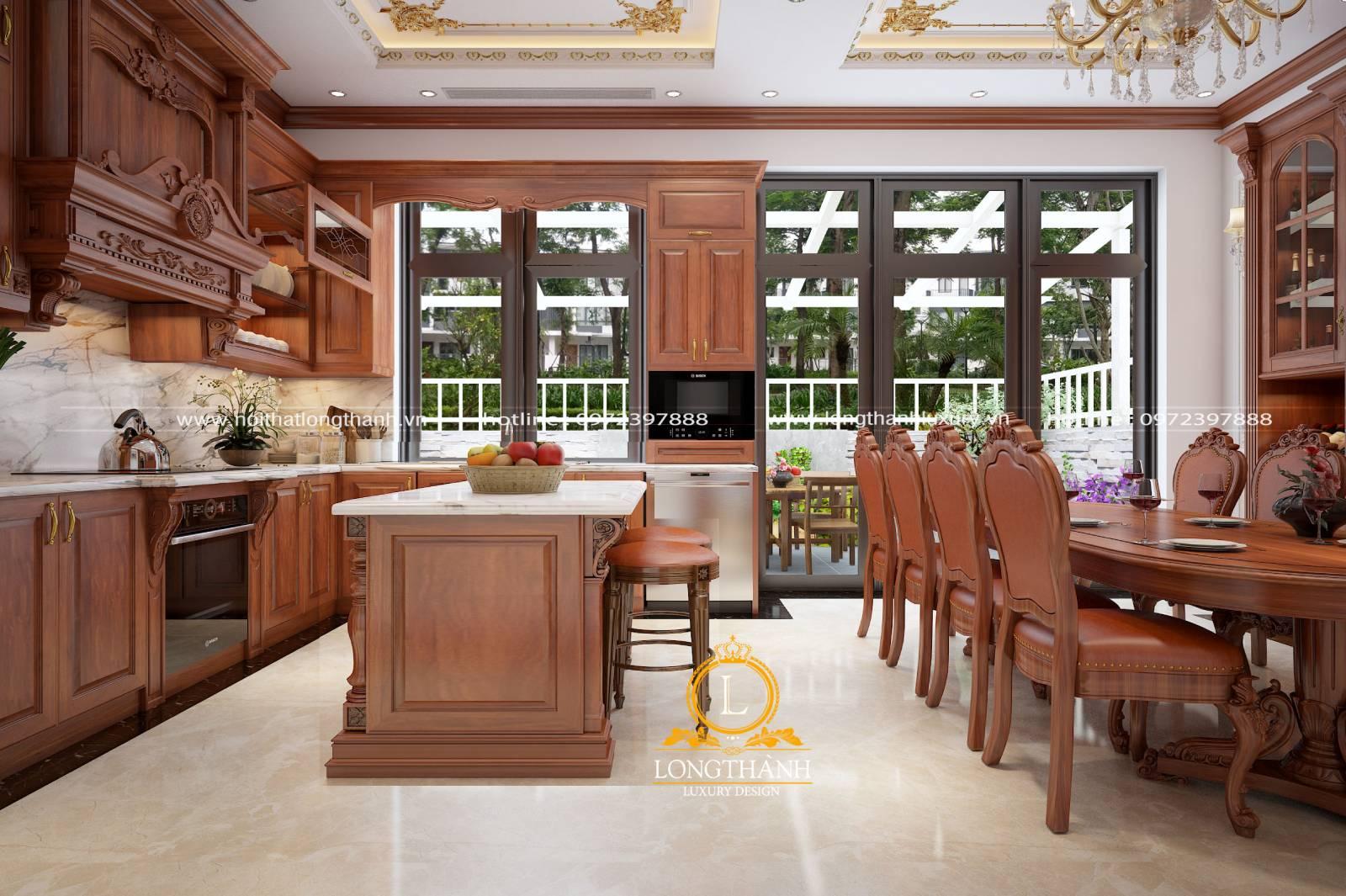 Tổng thể nội thất phòng bếp tiện lợi sang trọng với mẫu tủ bếp gỗ Gõ kết hợp bàn đảo